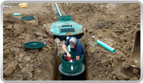 Picture of man working on installing a new sewer line